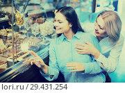 Купить «women buying dark and white chocolate filled candies», фото № 29431254, снято 31 марта 2020 г. (c) Яков Филимонов / Фотобанк Лори