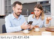 Купить «Irritated spouses with phones», фото № 29431434, снято 24 мая 2018 г. (c) Яков Филимонов / Фотобанк Лори