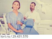 Купить «Dentist with assistant are fooling around in the workplace», фото № 29431570, снято 10 июля 2017 г. (c) Яков Филимонов / Фотобанк Лори