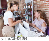 Купить «Administrator talking with client about services in nail salon», фото № 29431598, снято 30 мая 2018 г. (c) Яков Филимонов / Фотобанк Лори