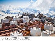 Купить «Metal piles and concrete cubes on the slope», фото № 29435382, снято 5 июля 2015 г. (c) katalinks / Фотобанк Лори