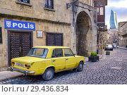Купить «Old yellow soviet car (Moskvitch) in Icheri Sheher (Old City), Baku, Azerbaijan.», фото № 29436834, снято 24 марта 2017 г. (c) age Fotostock / Фотобанк Лори