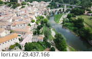 Купить «Aerial view of historic centre of Besalu with Romanesque bridge over Fluvia river, Catalonia, Spain», видеоролик № 29437166, снято 23 июня 2018 г. (c) Яков Филимонов / Фотобанк Лори