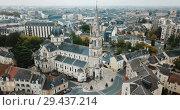 Купить «Aerial view of picturesque Chateauroux cityscape with Catholic Church of Our Lady, central France», видеоролик № 29437214, снято 26 октября 2018 г. (c) Яков Филимонов / Фотобанк Лори
