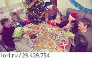 Купить «Family exchanging Christmas gifts», фото № 29439754, снято 19 ноября 2019 г. (c) Яков Филимонов / Фотобанк Лори