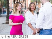 Купить «Stranger man is talking with young females who are resting», фото № 29439858, снято 18 октября 2017 г. (c) Яков Филимонов / Фотобанк Лори