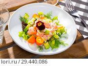 Купить «Ceviche of trout with avocado, cumquat, greens», фото № 29440086, снято 21 октября 2019 г. (c) Яков Филимонов / Фотобанк Лори