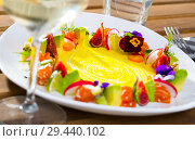 Купить «Raw salmon tartare with fruits, vegetables, flowers», фото № 29440102, снято 15 ноября 2019 г. (c) Яков Филимонов / Фотобанк Лори