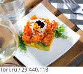 Купить «Cube of tasty tartar from red fish and avocado served on plate», фото № 29440118, снято 23 октября 2019 г. (c) Яков Филимонов / Фотобанк Лори