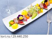 Купить «Tasty fried tuna with mango and avocado, served with fig and flower», фото № 29440250, снято 14 октября 2019 г. (c) Яков Филимонов / Фотобанк Лори