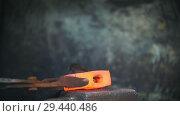 Купить «Blacksmith working with electric hammer on the anvil, worker making holes in red hot steel, craft», видеоролик № 29440486, снято 27 мая 2020 г. (c) Константин Шишкин / Фотобанк Лори