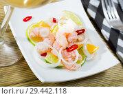 Купить «Ceviche with shrimps, lime, orange», фото № 29442118, снято 21 ноября 2019 г. (c) Яков Филимонов / Фотобанк Лори