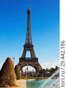 Купить «Eiffel Tower on blue sky background», фото № 29442186, снято 10 октября 2018 г. (c) Яков Филимонов / Фотобанк Лори
