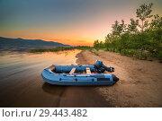 Купить «An inflatable boat with a motor on the shore of a sandy beach against the backdrop of a beautiful sunset.», фото № 29443482, снято 26 июля 2018 г. (c) Акиньшин Владимир / Фотобанк Лори