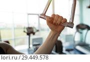 Купить «Close-up of new pull rope handle in a blurred gym», фото № 29449578, снято 27 сентября 2018 г. (c) Pavel Biryukov / Фотобанк Лори
