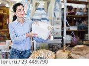 Купить «Smiling woman holding item for her apartment», фото № 29449790, снято 22 ноября 2017 г. (c) Яков Филимонов / Фотобанк Лори