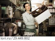 Купить «Adult woman choosing purpose basket», фото № 29449802, снято 22 ноября 2017 г. (c) Яков Филимонов / Фотобанк Лори