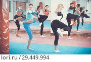 Купить «women are boxing and doing kick with coach», фото № 29449994, снято 8 октября 2017 г. (c) Яков Филимонов / Фотобанк Лори