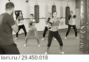 Купить «group of vigorous females and their trainer are boxing in gym», фото № 29450018, снято 8 октября 2017 г. (c) Яков Филимонов / Фотобанк Лори