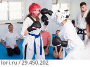 Купить «Women karate perform indicative sparring», фото № 29450202, снято 8 апреля 2017 г. (c) Яков Филимонов / Фотобанк Лори