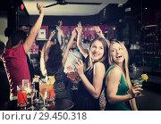 Купить «Teenagers celebrating end of session», фото № 29450318, снято 20 апреля 2017 г. (c) Яков Филимонов / Фотобанк Лори