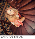 Купить «girl in silk robe stand on wooden spiral staircase», фото № 29450646, снято 26 апреля 2017 г. (c) katalinks / Фотобанк Лори