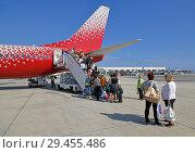 Купить «Larnaca, Cyprus - November 6. 2018. Passengers enter the plane through door in tail. Rossiya airline», фото № 29455486, снято 6 ноября 2018 г. (c) Володина Ольга / Фотобанк Лори