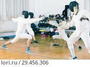 Купить «Young fencers training with coach», фото № 29456306, снято 30 мая 2018 г. (c) Яков Филимонов / Фотобанк Лори