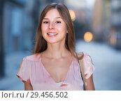 Купить «close-up portrait of smiling slim adult girl in sexy evening apparel», фото № 29456502, снято 26 августа 2017 г. (c) Яков Филимонов / Фотобанк Лори