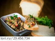 Купить «eggplant caviar with tomatoes and a slice of bread», фото № 29456734, снято 21 ноября 2018 г. (c) Peredniankina / Фотобанк Лори