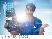 Купить «Doctor looking at x-ray image in telehealth concept», фото № 29457502, снято 26 марта 2019 г. (c) Elnur / Фотобанк Лори