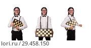 Купить «Funny man with chessboard isolated on white», фото № 29458150, снято 25 ноября 2013 г. (c) Elnur / Фотобанк Лори