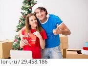 Купить «Young family celebrating christmas in new home», фото № 29458186, снято 17 июля 2018 г. (c) Elnur / Фотобанк Лори