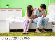 Купить «Young woman consoling disappointed impotent husband», фото № 29459066, снято 25 июня 2018 г. (c) Elnur / Фотобанк Лори