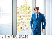 Купить «Young handsome man with crutches in conflicting priorities conce», фото № 29459210, снято 25 августа 2018 г. (c) Elnur / Фотобанк Лори