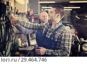 Купить «Smiling men in coveralls working», фото № 29464746, снято 19 января 2019 г. (c) Яков Филимонов / Фотобанк Лори