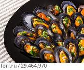 Купить «Image of mussels with sauce», фото № 29464970, снято 25 июня 2018 г. (c) Яков Филимонов / Фотобанк Лори