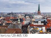 Купить «Skyline of Copenhagen with spire of City Hall», фото № 29465130, снято 10 декабря 2017 г. (c) EugeneSergeev / Фотобанк Лори
