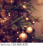 Купить «decorations on a Christmas tree and glare of lights», фото № 29465870, снято 4 ноября 2017 г. (c) katalinks / Фотобанк Лори