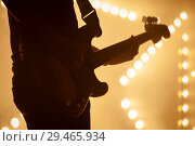 Купить «Electric bass guitar player in stage strobe lights», фото № 29465934, снято 11 декабря 2016 г. (c) EugeneSergeev / Фотобанк Лори