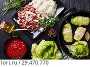 Купить «uncooked stuffed cabbage leaves, flat lay», фото № 29470770, снято 22 ноября 2018 г. (c) Oksana Zh / Фотобанк Лори