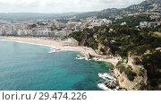 Купить «Picturesque aerial view of Mediterranean coastal town of Lloret de Mar in Catalonia, Spain», видеоролик № 29474226, снято 11 июня 2018 г. (c) Яков Филимонов / Фотобанк Лори
