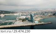 Купить «View from drone of Barceloneta beach with luxury hotel W Barcelona», видеоролик № 29474230, снято 25 августа 2018 г. (c) Яков Филимонов / Фотобанк Лори