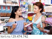 Купить «Stylish girl and mother choosing new nail polishes, shopping in cosmetics store», фото № 29474742, снято 21 июня 2018 г. (c) Яков Филимонов / Фотобанк Лори