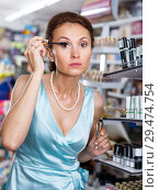 Купить «Woman testing mascara in cosmetic shop before buying», фото № 29474754, снято 21 июня 2018 г. (c) Яков Филимонов / Фотобанк Лори