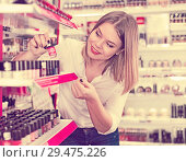 Купить «Woman looking for new color of nail varnish», фото № 29475226, снято 31 января 2018 г. (c) Яков Филимонов / Фотобанк Лори