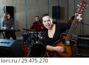 Купить «excited girl rock singer with guitar during rehearsal», фото № 29475270, снято 26 октября 2018 г. (c) Яков Филимонов / Фотобанк Лори