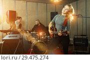 Купить «Cheery guitar player and singer with band», фото № 29475274, снято 26 октября 2018 г. (c) Яков Филимонов / Фотобанк Лори