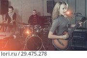 Купить «excited girl rock singer with guitar during rehearsal», фото № 29475278, снято 26 октября 2018 г. (c) Яков Филимонов / Фотобанк Лори