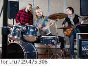 Купить «Music band with positive girl drummer rehearsing», фото № 29475306, снято 26 октября 2018 г. (c) Яков Филимонов / Фотобанк Лори